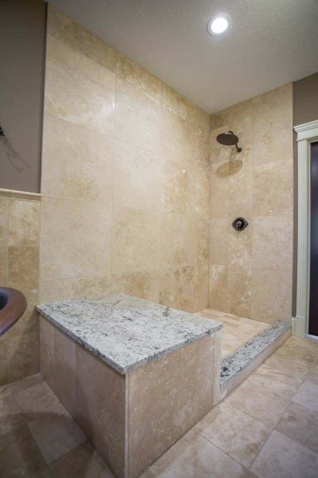 Large custom tile shower with built in bench
