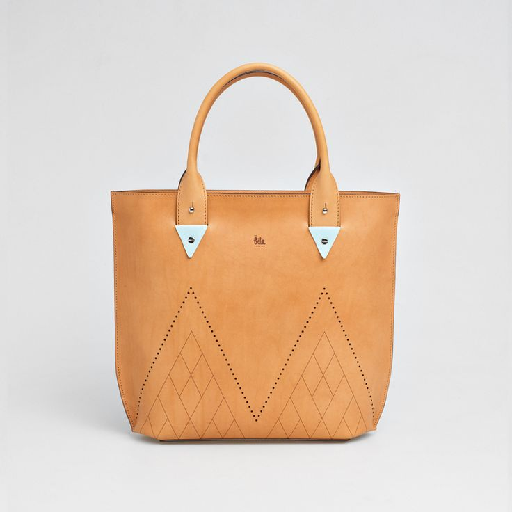 TheBétaVersion Frida shopper in vegetable tanned leather with pastel blue appliqués and laser cut geometric pattern