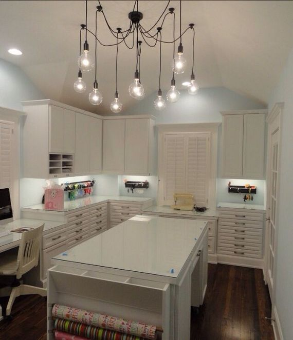 50 Amazing and Practical Craft Room Design Ideas and Inspirations. Love the lighting, wrapping paper holder and lots of storage.