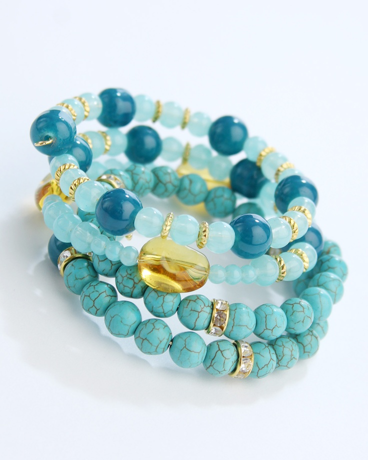 Vi Bella Jewelry - Olivia Bracelet - Olivia Bracelet - The Olivia Bracelet is spectacular!  Made of large oblong clear mustard colored beads, rhinestone bejeweled gold beads, small gold accent disc beads, and tea and  turquoise beads strung on memory wire, this bracelet is perfect on its' own or with the Olivia Necklace and earrings.     Length - memory wire spiral one size fits all      Handcrafted by Vi Bella Artists in Haiti.  $29.95