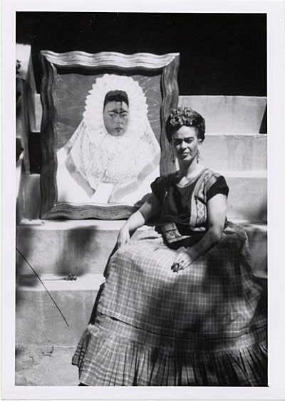 * Frida Kahlo with her painting, Self-Portrait as a Tehuana 1943 - photo Florence Arquin