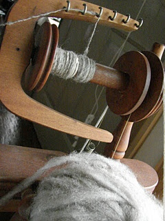 Spinning washed and combed, raw wool onto spindles to use as yarn for knitting, crocheting and weaving.