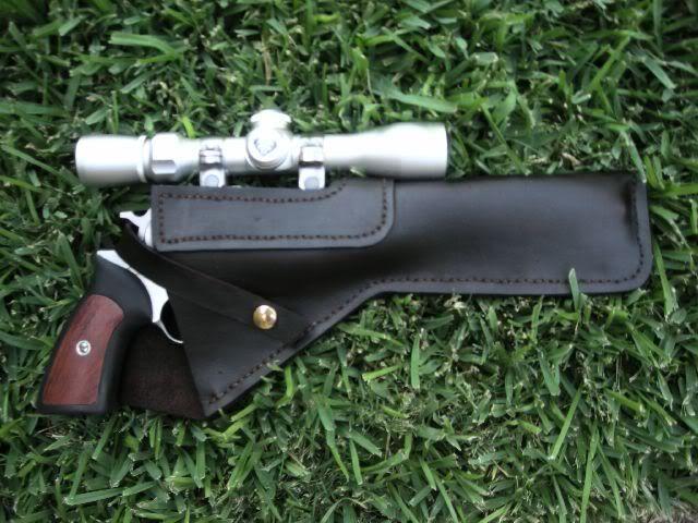 ruger super Blackhawk with scope.