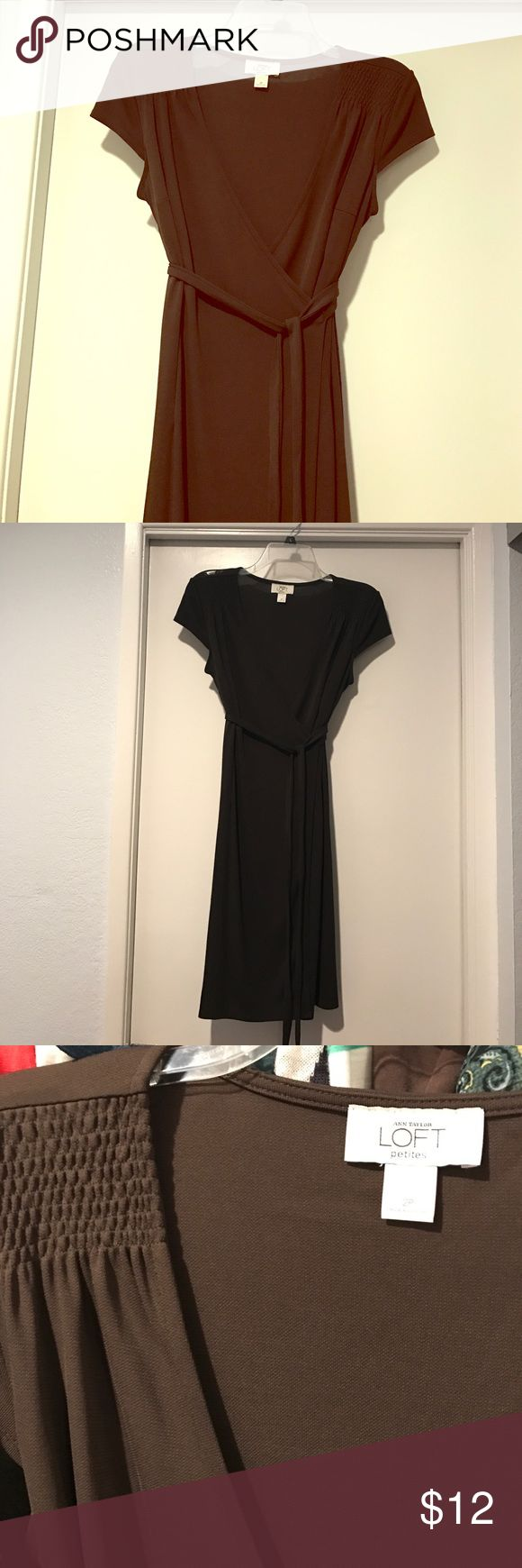 Loft brown petite wrap dress Loft petite wrap dress in a beautiful chocolate brown color. Detailing at shoulders. Attached belt. 65% rayon 35% polyester. Good condition. Light signs of wear. No smells. Very subtle deodorant mark at armpits. Like most Loft clothes this runs big. I'm usually a 4/6 and the fabric is stretchy with a good amount of give. LOFT Dresses Mini