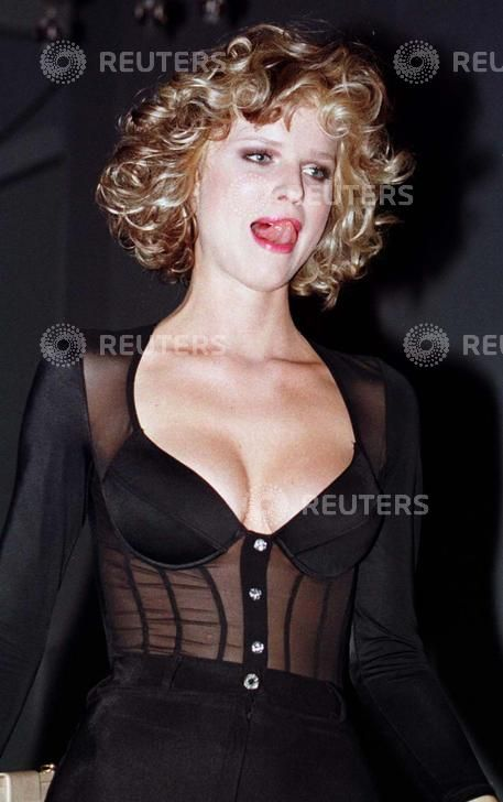 11 July, 1996 Supermodel Eva Herzigova licks her lips July 10 as she meets the press briefly after she performed in a fashion show featuring swimming suits by a Turkish designer Zeki Triko