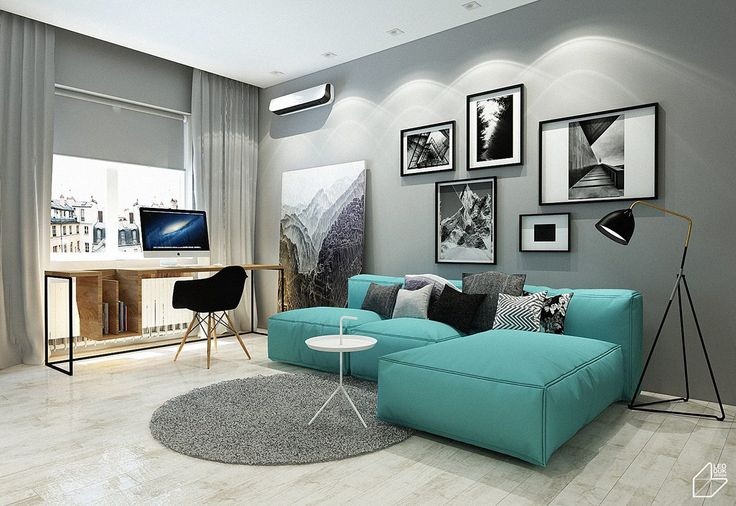 rectangular frames of various sizes, grey wall, small spotlights from above, light wood floor