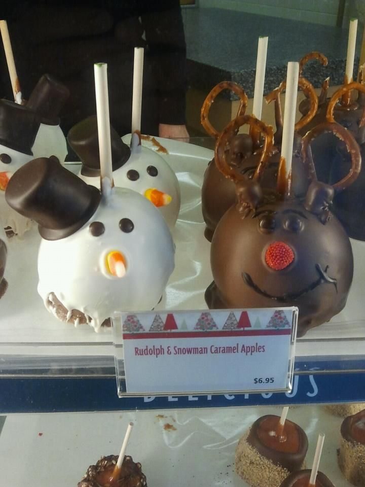 Too cute!    Frosty the Snowman and Rudolph the Red-Nosed Reindeer caramel apples from Rocky Mountain Chocolate Factory.