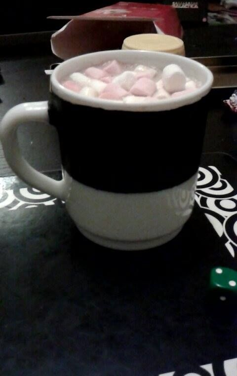 Chalkboard mugs with a hot chocolate kit (mini marshmallows, hot chocolate, and biscuit sticks) for presents.