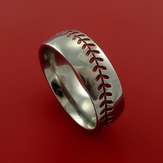 This 8mm wide TITANIUM ring has a POLISH FINISH and RED Stitching that encircles the band like a Baseball. The Stitching pattern is carved into