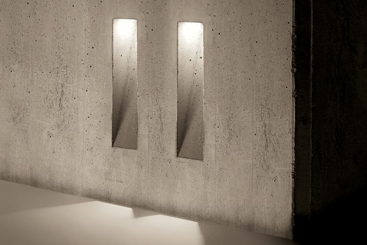 Marc Sadler for Simes: the light blade comes from the concrete The light blade comes from the concrete. When it's off, it disappears. No artifice, just a cut in the concrete with brutal and magic inspiration: Actually a technical prodigy, directly casted into the concrete , the product of a sophisticated and invisible genius to fuse architecture and light in a natural way.