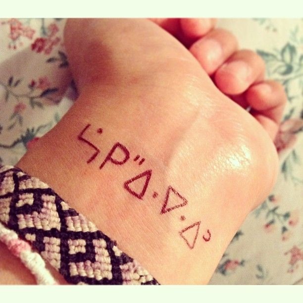 I wrote this on my wrist and shortly after got a little inspired. It is love in Ojibway syllabics :)