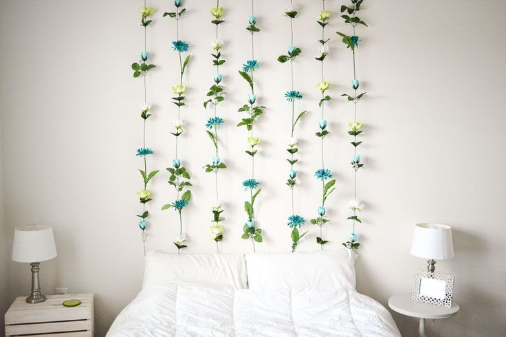 A very easy tutorial on how to make a flower wall using fake flowers, hot glue, a few nails and a bit of fishing line. Perfect for a headboard.