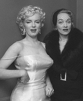 Marilyn and Marlene Dietrich at a press conference announcing the formation of Marilyn Monroe Productions. Photo by Milton Greene, January 7th 1955.