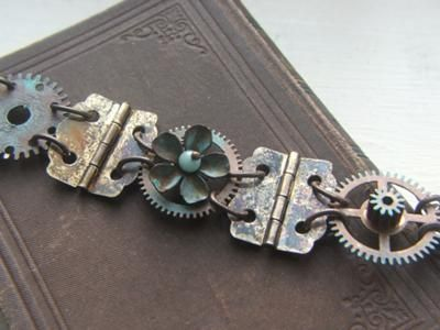 Up-cycled jewelry from hinges and gears  Gloucestershire Resource Centre  http://www.grcltd.org/scrapstore/