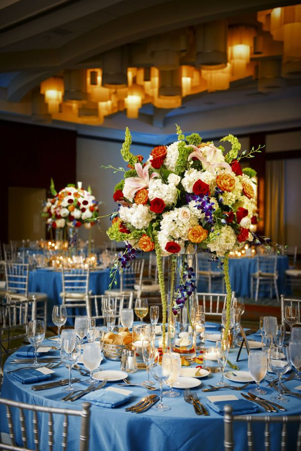 Gorgeous tropical centerpieces and aqua tablecloths (Photo by Jeff Kolodny Photography)