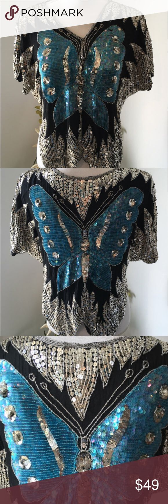 Vintage butterfly blouse 100% silk Vintage heavily sequined Butter Fly blouse on 100% silk fabric.  One size fits those size 10 or smaller, made in India.  This blouse is so very delicate and light considering the sheer number of sequins on it.  Sequin is in very good condition, with minimal loose or removed.  It appears the previous owner has closed the V front with two stitches.  These likely could be removed.  This blouse is not dry cleanable, nor is washing recommended.  Beautiful…