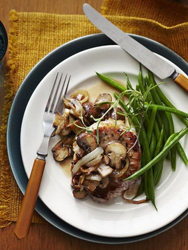 Thanks to no-guilt mushroom gravy and meaty center-cut chops, this skinny version of the Southern classic is more hearty than heavy.