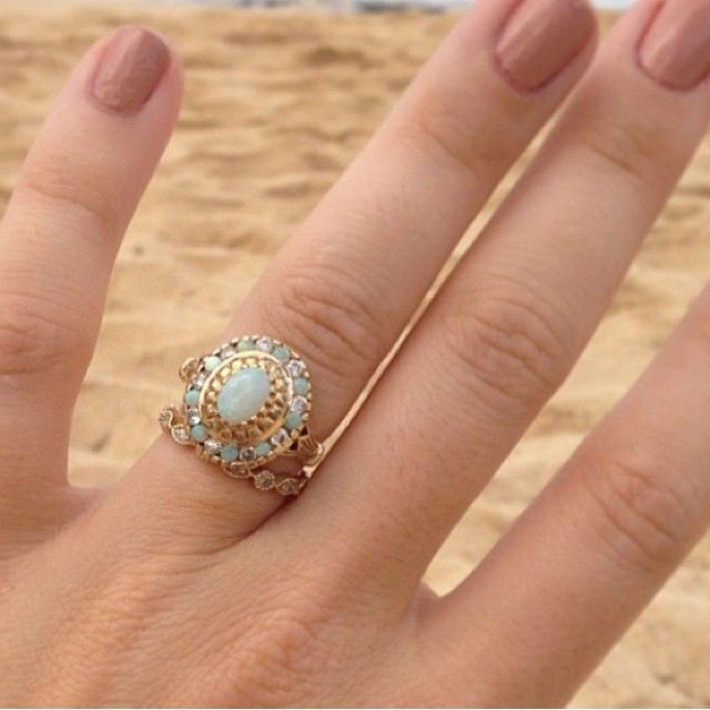 Her engagement ring is similar in size and shape to mine and it actually doesn't look bad with the wedding band. Good thing for me to keep in mind when I search for my wedding band :)