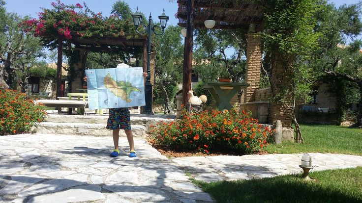 Our little friend can help you with the directions! #PaliokalivaVillage #FamilyHolidays Photo credits: Vassilis Bartzokas