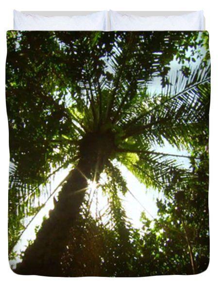 Zanzibar Island Coconut Tree 85 degree sky facing photography of the green umbrella pattern of branc Duvet Cover by NAVIN JOSHI