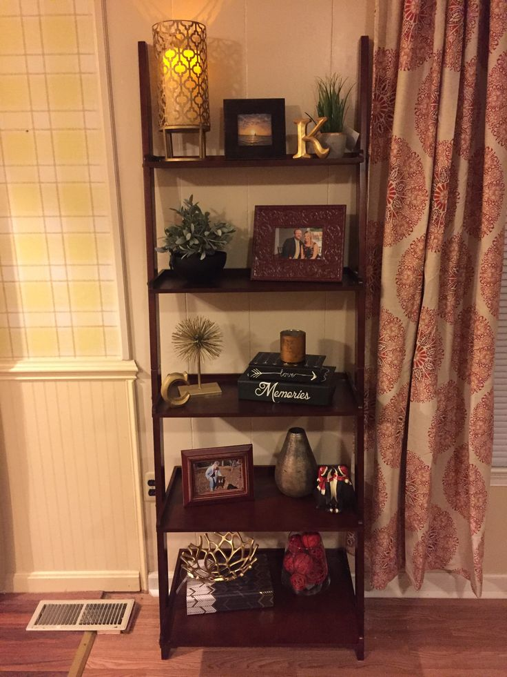 Decorating a leaning bookshelf for Shelf decorating ideas