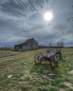 Old wagon in an old yard in saskatchewan