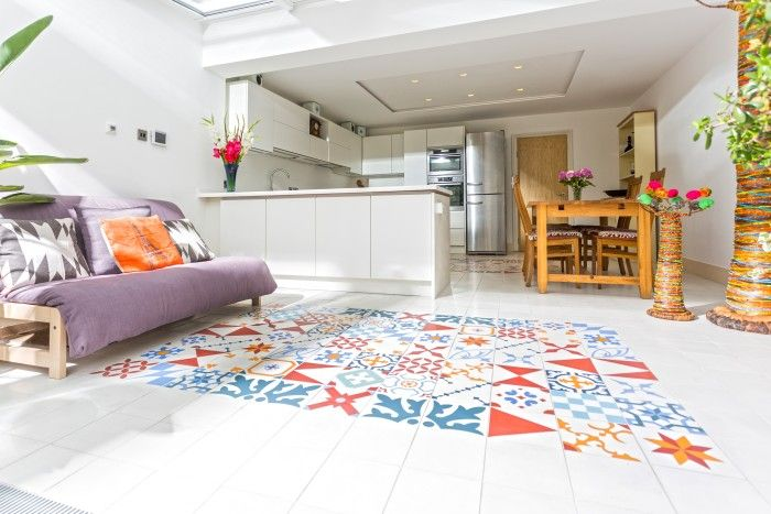 Bespoke Patchwork Encaustic Tiles from Alhambra Tiles used on the floor to zone the living area.