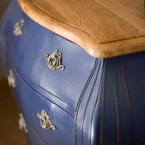 Blue chest of drawers or commode for seaside holiday home.