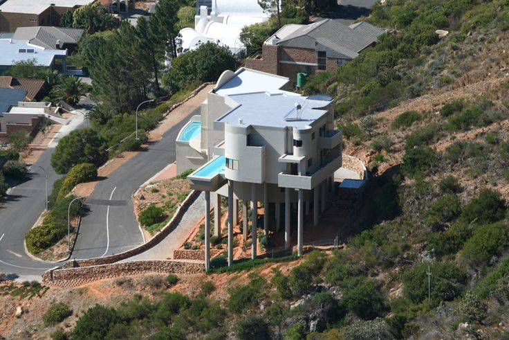 House in Gordons Bay - build on stilts for the mountain fires - look at swimming pool