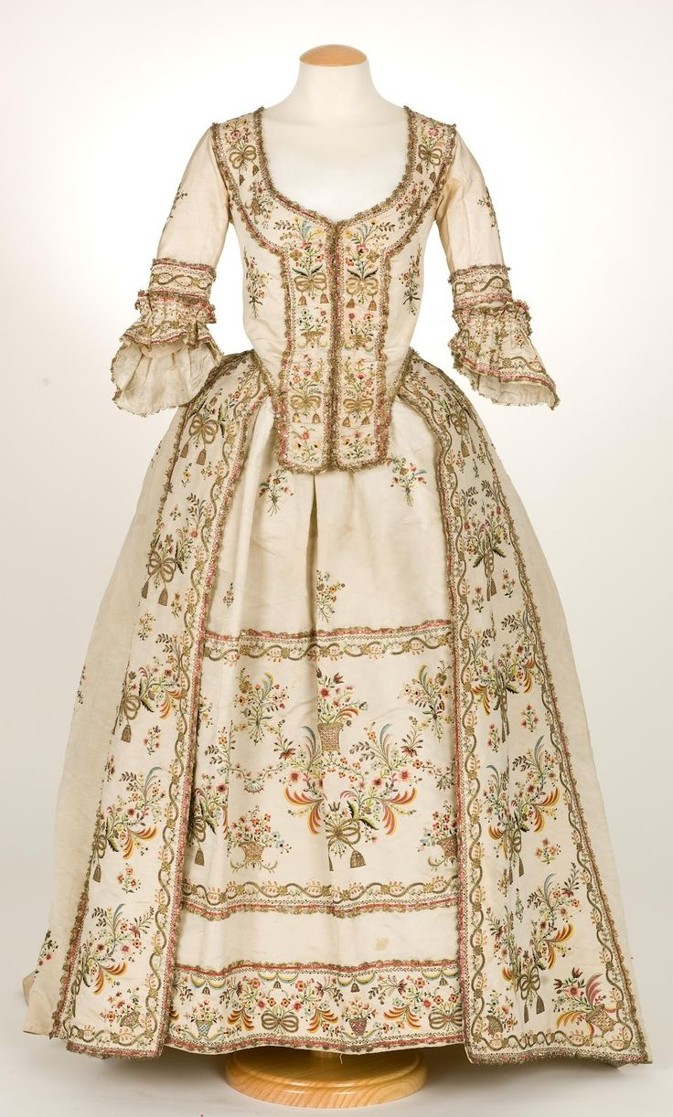 Sacque gown a la Piedmontese, ca. 1780, Italy (?), plain cream ribbed silk, metallic and silk embroidery.  Metallic lace borders all the embroidery elements, with additional spangles adding even more sparkle to the design.