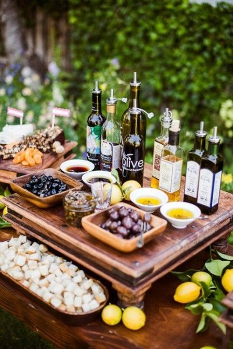 Farmers market style food stations: cheeses, breads, fruits, vegetables, meats/fish, and olives/olive oil. Then drinks, desserts, and main course dishes.