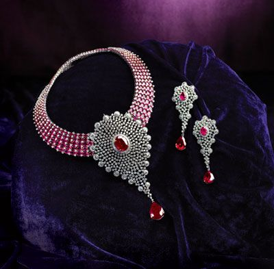 TBZ - The Original: Adorn this beautiful diamond necklace with the shine of pink and be the centre of attraction tonight! For Store details visit: http://www.myweddingbazaar.com/vendor.php?tpages=3&page=3&vendor_type=Jewellery