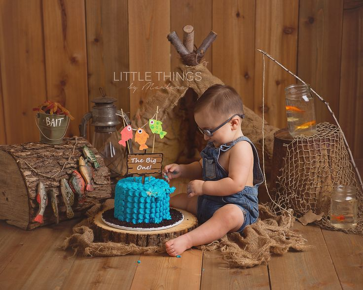 Little Things by Marlena - Boise Idaho newborn photograper. cake smash. gone fishing. rustic. teepee. burlap. blue cake. the big one. fishing theme. first birthday fishing theme.   www.littlethingsbymarlena.com