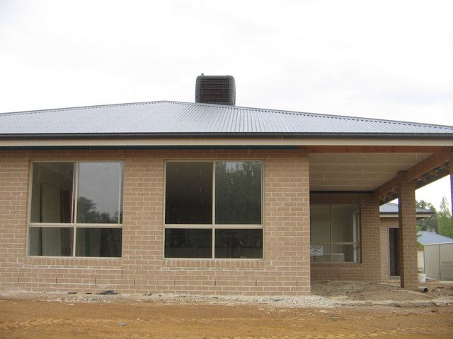 Boral Graphite With Moniment Colorbond Roof And Paperbark