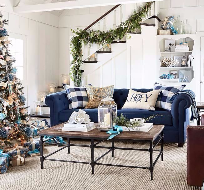 A Coastal Christmas Tree That Sparkles Shines With Blue Jeweled Ornaments Blue Couch Living Room Christmas Living Rooms Blue Sofas Living Room