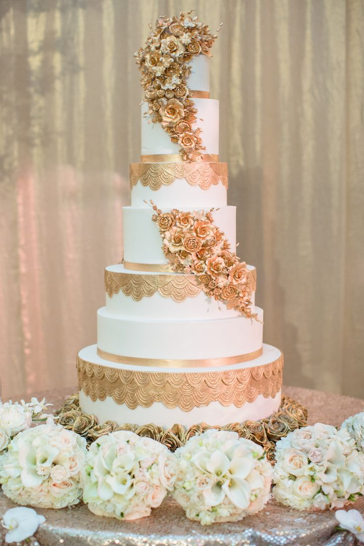 Tall, Elegant Cake with Gold Geometric Designs & Sugar Flowers | Photography: Thisbe Grace Photography. Read More: http://www.insideweddings.com/weddings/gorgeous-tented-wedding-in-texas-with-neutral-gold-color-palette/677/