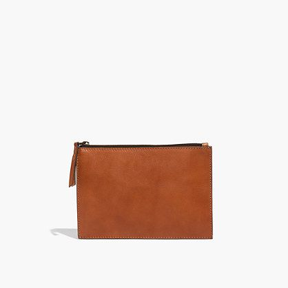 """This streamlined leather pouch is fitted out with card slots and a snap-close compartment. Throw it inside your tote or carry it as a clutch—it's that versatile. Please note: As leather is a natural material, each pouch varies slightly in texture and color. We love the way each one wears in differently, taking on a special character all its own. <ul><li>Leather.</li><li>Zip closure.</li><li>6""""H x 9""""W.</li><li>Import.</li></ul>"""