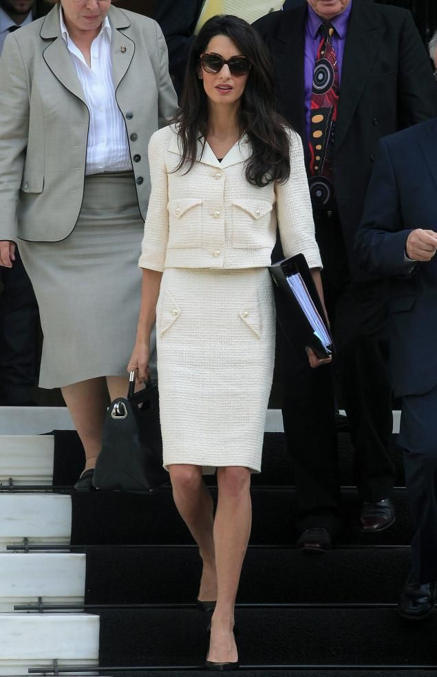 Amal is on day two of her four-day visit to Greece, but no she is not on her honeymoon! The 36-year-old human rights lawyer strictly means business. Here, the new Mrs. Clooney looks fashionably sophisticated in a cream colored suit as she leaves the Maximos Mansion after a meeting with Greek Prime Minister Antonis Samaras in Athens, Greece on Oct. 15, 2014.