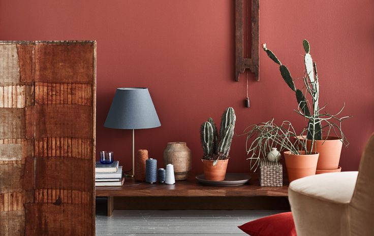 We think using combining earthy red colors with blue accent colors and dark wood furniture is a big upcoming trend.