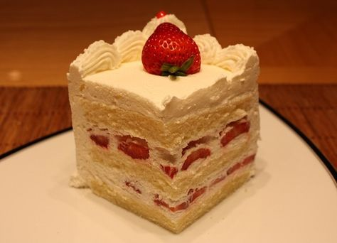 Quarter sheet white cake with whip cream and strawberries