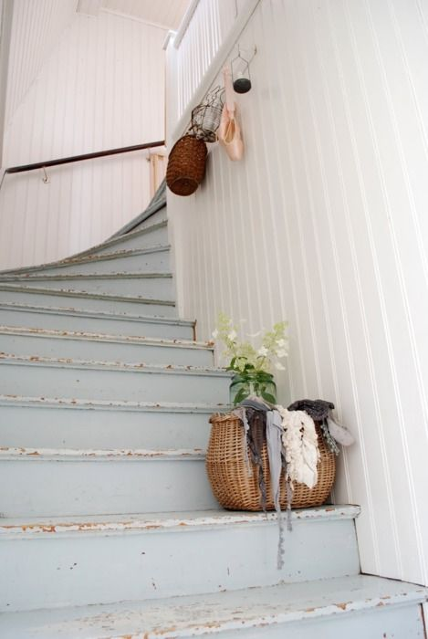 love the blue scuffed stairs.  Relaxed and friendly for wear and tear of a family.