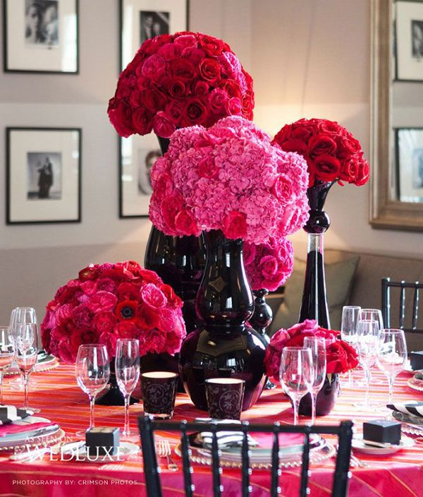 Bright pink and red flowers in black vases // Kate Spade-Inspired Wedding Moodboard #roses {Facebook and Instagram: The Wedding Scoop}