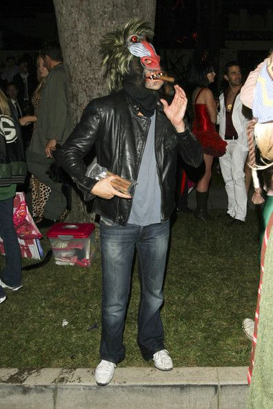 """Leonardo DiCaprio Photos - What a Baboon! Leonardo DiCaprio tries to smoke a cigar through his Halloween mask. The """"Shutter Island"""" actor was outside a private Halloween party in Beverly Hills. - Leonardo DiCaprio at a Halloween Party in Beverly Hills"""