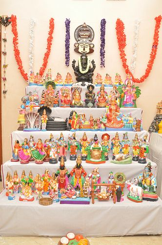Kolu is adorned with dolls – predominantly with that of the gods and goddesses depicting mythology. It is a traditional practice to have at least some wooden dolls. There should also be a figurine of a boy and a girl together called 'Marapacchi' Bommai