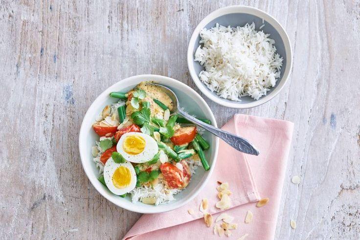 Eieren met mildpittige currysaus en rijst - Recept - Allerhande