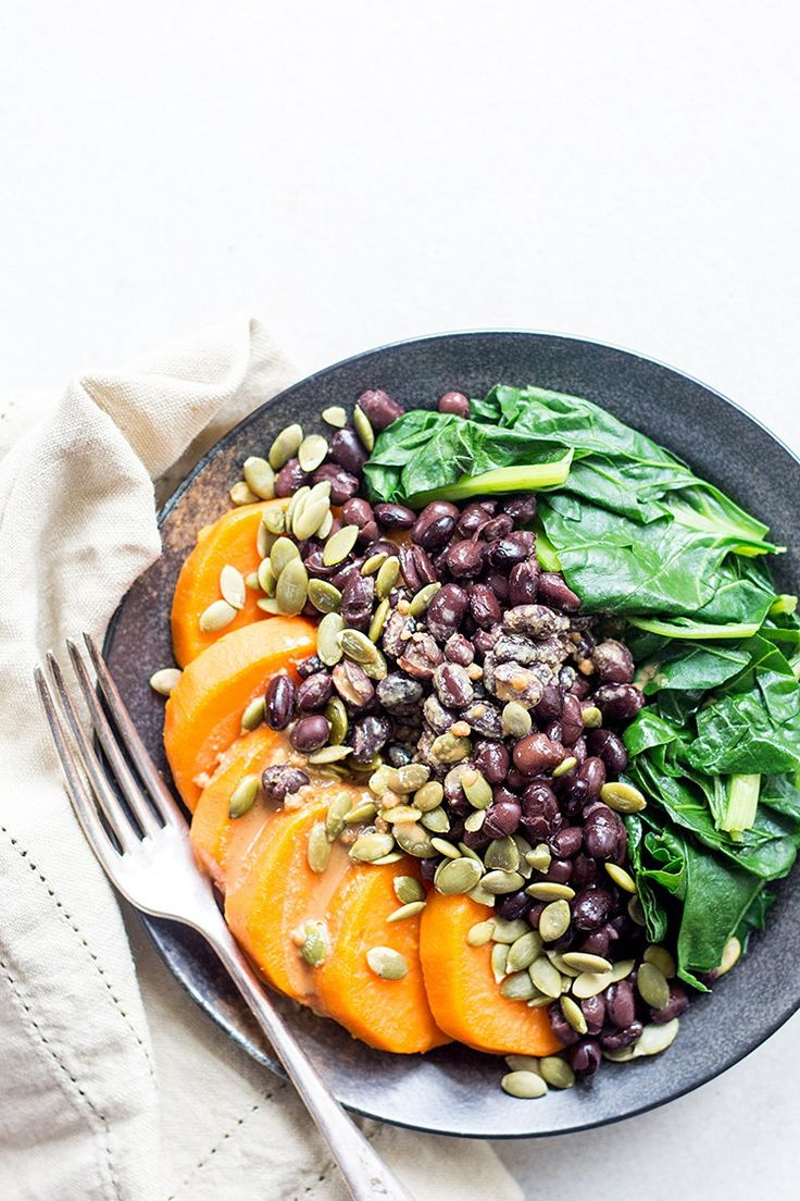 Black bean, sweet potato and spinach protein bowl with tahini and tamari dressing (vegan and gluten free).