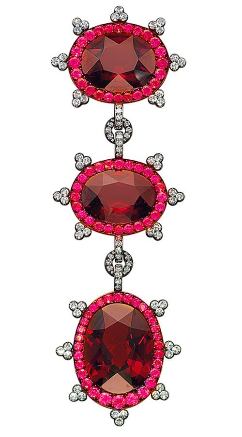 Garnet, Ruby and Diamond Brooch, by JAR designed as three clusters, each centering upon an oval-shaped garnet, weighin approximately 41.36, 33.25 and 28.42 carats, to the ruby and diamond surround and trefoil detail, mounted in silver and gold, 2001, 21.0 cm Signed JAR Paris