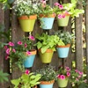 Bright blue, green, yellow paint for pots to hang on patio or back fence. Outdoor Wall Art!