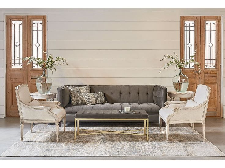 All dressed up with its tailored tuxedo styling, this transitional styled Tailor Sofa from Magnolia Home is a true eclectic mixer.