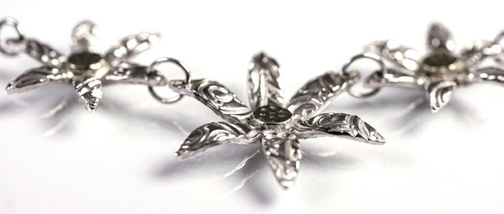 Designed and made by Nuit Nuit - A three flower fine silver necklace